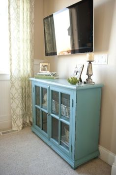 love the blue cabinet with glass doors- now just where can i find one???