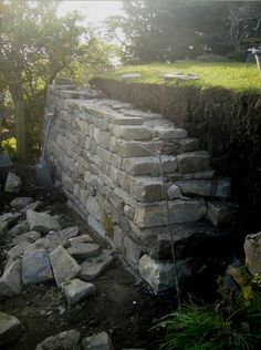 dry stone retaining wall. gonna need to do this in my new backyard