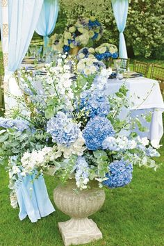 Don't be afraid to mix different tones of blue together throughout the styling - particularly in your flowers, as seen on BridesMagazine.co.uk (BridesMagazine.co.uk)
