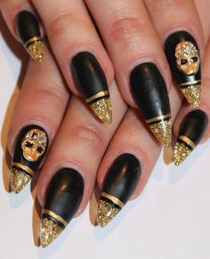i don't care for the little character on the two nails. I love the color combo and shape of these nails!!