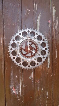 Saw blade, motorcycle sprocket and bicycle sprocket recycled wall clock