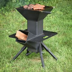 """If Rorschach were a grillin' man, the Watchman Stove is what he'd use. This outdoor cooker can make multiple face changes too, with 2 primary cooking options, plus a warming """"Potato Plate,"""" plus any new ways of using the stove you come up with while you Outdoor Cooking Stove, Outdoor Stove, Metal Projects, Welding Projects, Bbq Grill, Grilling, Rocket Stove Design, Cooking With Charcoal, Seasoned Wood"""
