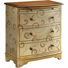 """3-drawer wood chest in ivory with a pull-out tray and hand-painted scroll motif.    Product: ChestConstruction Material: WoodColor: IvoryFeatures: Three drawersOne pull-out tray  Hand-painted scroll motifDimensions: 27.25""""  H x 24""""  W x 14""""  D"""
