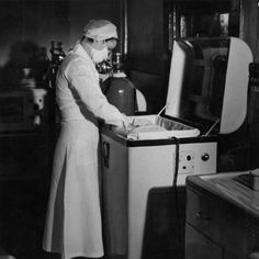A St. Paul nurse attends to a baby in an incubator.    Date Circa 1945