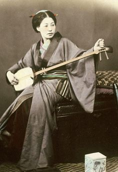 Playing the samisen. Hand-colored photo, 1870's, Japan, by photographer Felice Beato