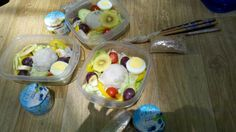 Spring salad pack. Golden kiwi, grape, cherry tomatoes, sweat pepper, lettuce, boiled egg and scooped mashed potatoes. Yogurt for dressing.
