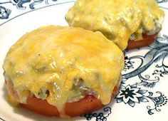 TUNA MELTS 2 servings Tuna Salad 1 large tomato, about 6 1/2 ounces before trimming * 2 ounces cheddar or American cheese, shredded Slice the stem and bottom ends off the tomato then cut into 4 thick slices. Place the tomato slices on a foil-lined baking sheet. Mound some tuna salad on each tomato slice. Top each with 1/4 of the cheese and broil until the cheese is melted. Makes 2 servings
