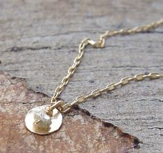 This golden circle and diamond combo.   23 Pieces Of Jewellery For Anyone Who's A Diamond In The Rough