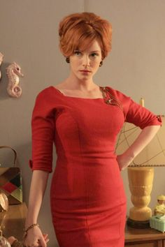 Joan Holloway Harris. Runs a tight ship and looks fantastic while doing it.