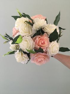 A pretty pink and ivory white bridal wedding posy bouquet. Includes realistic looking pink and white artificial roses and white carnations. The Posy is complimented with ficus leaves. The handle is wrapped in ivory white ribbon with a diamante finish. White Carnation, White Bridal, White Ribbon, Carnations, Handmade Wedding, Pretty In Pink, Wedding Bouquets, Projects To Try, Floral Wreath
