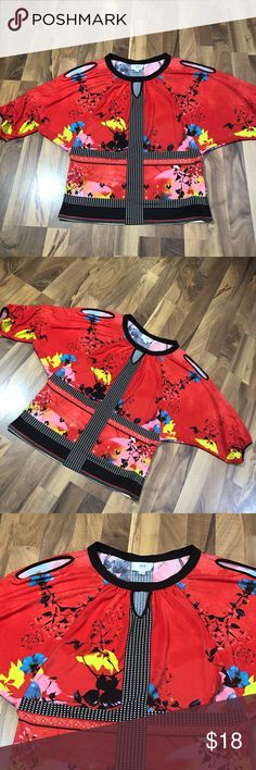 Women's Size Medium Asian Inspired Blouse Top This cute Asian inspired top is up for sale! Great condition! Cute!  ❤ bright red with other colors ❤ key hole accents at shoulder of each sleeve ❤️gorgeous design and detail  ❤ Size Measured in Pictures 🔍📏   ✅ Bundle up items and save 💲✅  ❤️ I love reasonable offers. ❤️ 🎉 Pair w/jewelry, acc. or shoes🎉 🆕 New items every week! 🆕  I'm a mama on a mission. I sell items online to support my 2 sons. Every purchase is important to us. 😘 ECI…