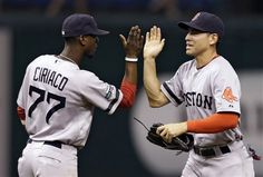 Boston Red Sox's Jacoby Ellsbury, right, high-fives teammate Pedro Ciriaco after the team defeated the Tampa Bay Rays 5-2 during a baseball game, Monday, Sept. 17, 2012, in St. Petersburg, Fla. (AP Photo/Chris O'Meara)