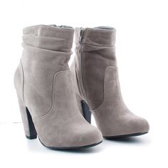 Doll up any outfit with these classic zip up ankle booties, featuring a round toe, contrast stitching, a side zipper for easy wear and closure, a slightly cushioned insole, and an approximate 4 inch h