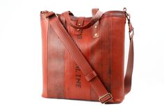 Elvis & Kresse Tooley Tote at Supernomad - £260. Re-engineered from London Fire Brigade fire hoses.