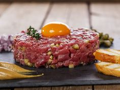 """According to the legend, the name """"Steak or Beef Tartare"""" refers to the Tartars, the nomads who roamed Eastern Europe, for a time under the leadership of Attila the Hun. Fierce and bloodthirsty, the Tartars purportedly ate raw meat for strength."""