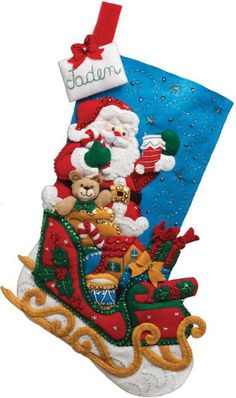 Bucilla Santa and His Sleigh - Christmas Stocking Felt Applique Kit. Festive designs, quality materials and generous embellishments continue to make Bucilla fel Christmas Stocking Kits, Felt Christmas Stockings, Felt Stocking, Christmas Sewing, Christmas Crafts, Christmas Ornaments, Christmas Sock, Christmas Holiday, Felt Decorations