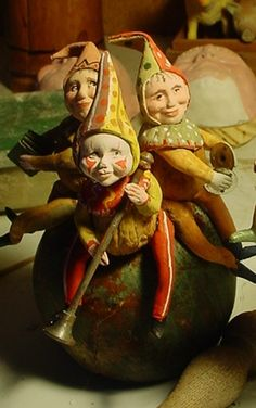 """I am working on this piece right now, three elves on a toad stool.  It will be 13 in. tall and will be held in the hand of a 30 in. Santa that David and I are having fun making.. We call this """"The Band"""" watch for it."""