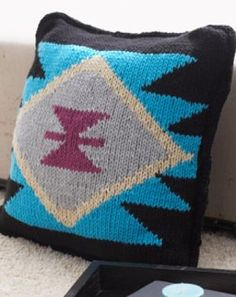 Tribal designs and southwestern motifs are all the rage, and this trendy knit pillow pattern is no exception. The Aztec Inspired Knit Pillow Pattern is the perfect way to incorporate this graphic fashion trend into any room of your home. Bold colors and fun, geometric shapes make this pattern a great exercise in colorwork.