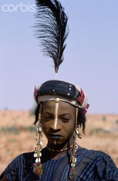 Africa   Wodaabe-Bororo man with his face painted for the annual Gerewol male beauty contest.  Niger   © Tiziana and Gianni Baldizzone