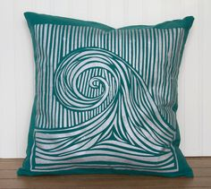 A pillow stencilled with a gorgeous, curling wave. #NauticalJuly