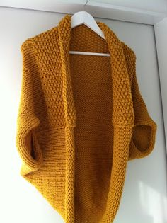 m.i.l.c.h.schaum: Shrug is knit in one piece , which measures approx. 70 x 95 cm.  Cast on 64 sts on needle size 12 and knit moss stitch (= 1 , purl 1 row to go, and on the following rows purl over K and P over K ) . Work until piece measures 20 cm . Then continue in stockinette until piece measures 95 cm. Cast off loosely.  Assembly: Fold the piece in half and sew side seams together , but leave a gap of approx . 21 cm stand for armhole.