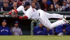 Boston Red Sox third baseman Pablo Sandoval makes a diving catch on a fly out by Toronto Blue Jays' Dalton Pompey during the fourth inning of a baseball game at Fenway Park in Boston, Monday, April 27, 2015. (AP Photo/Charles Krupa) Boston Red Sox Team Photos - ESPN