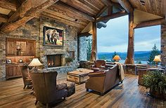 Wood, stone, and big ole windows with a mountain view. Get rid of that weird bear painting, and you have a pretty perfect room.