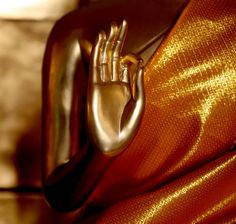 "Buddhas and bodhisattvas often are depicted in Buddhist art with stylized hand gestures called mudras. The word ""mudra"" is Sanskrit for ""seal"" or ""sign,"" and each mudra has a specific meaning. Buddhists sometimes use these symbolic gestures during rituals and meditation.  In the vitarka mudra the right hand is held at chest level, fingers pointing up and palm outward. The thumb and index finger form a circle. Sometimes the left hand is held with fingers pointing downward, at hip"