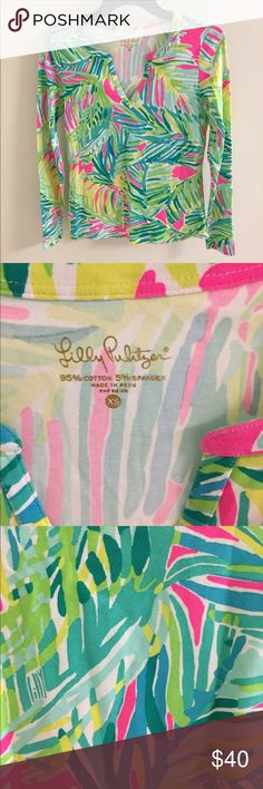 New without tags! Lilly Pulitzer shirt 🎀 Never worn! New without tags! I just love the bright summery print in classic Lilly colors. I live near Lilly headquarters in king of Prussia PA and go to their warehouse sale every year! Lilly Pulitzer Tops Tees - Long Sleeve