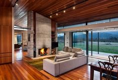 Unique concrete faced fireplace. Modernist Residence by Lawson Homes