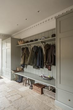 A painted traditional English country house bootroom designed by Artichoke. Visit our website for more images of this bespoke project.