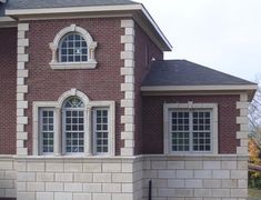 These windows are framed by a soldier course header and for Quoined brick corners