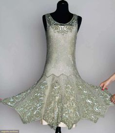 1920s seafoam green, silver bugle bead lattice pattern w/ irridescent sequined roses at neckline and hem.