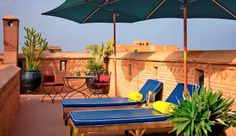 Rooftop terraces overlooking the Medina in Marrakesh and the Atlas Mountains