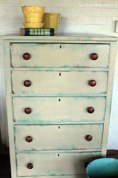 A distressed dresser finished in a beautiful layering technique using Chalk Paint® decorative paint by Annie Sloan in Antibes Green as a base and Versailles over top | By Circadee