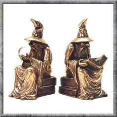 WIZARD BOOKENDS IN COLD CAST BRONZE by DESIGN CLINIC. One wise Wizard stares into a Crystal Ball whilst the other reads a mystical tome. A stunning set of magical bookends that would look amazing in any office, library or on any living-room shelf. These are very large, heavy and solid bookends.