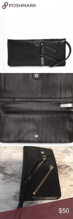 Rebecca Minkoff snap close black leather wallet Enough card slots and pockets to secure your plastic,cash, and other essentials. This thin wallet is finished with cool zipper accent and a signature hardware . Snap closure. Exterior zip pockets, interior currency pockets. 12 cars slots . It has been used a little has a flaw as in last picture in bend part . Has 3 small cracks . Does not go through . . Good ever where else . Rebecca Minkoff Bags Wallets