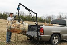 Pickup Crane by Bill Rosener -- Homemade pickup crane constructed from square tubing, pipe, a hitch receiver, and a chain hoist. http://www.homemadetools.net/homemade-pickup-crane