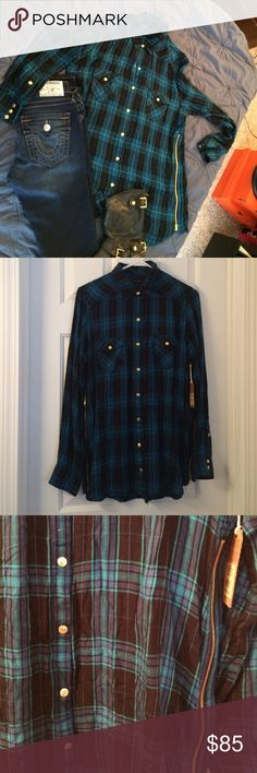 True religion flannel tunic please read entirely: Plaid zip tunic- color is hard to capture in lighting but it's black, blue, and greens. Both pockets button and there are zippers on both sides. SUPER SOFT (100%rayon) hand wash only! Has a tiny pin hole below collar (not noticeable but I'm all about honesty) price reflects it! True Religion Tops Button Down Shirts