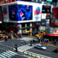 Tilt shift miniature faking is a technique in which the photographer manipulates the angle of a tilt-shift lens in order to create an illusionary effect of depth of field, so that some objects are focused while the other are really blurred.