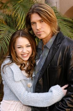 "Miley and Billy Ray Cyrus pose for this 2006 picture from a ""Hannah Montana"" press day."