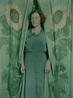 Woman with sunflower print curtains, 1900-1930, New Zealand, by James Chapman-Taylor. Autochrome. http://publicdomainreview.org/collections/autochromes-from-the-te-papa-collection/