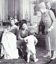 Four generations of royals - Queen Mary, Queen Mum, Queen Elizabeth II, and Princess Anne. That's Prince Phillip in the background with Prince Charles' back to the camera. Royal Queen, Queen Mary, Lady Diana, Prinz Phillip, Elizabeth Queen, Elizabeth Young, The Heir, Prinz Charles, Royal Families