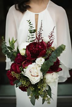 Brides.com: . A romantic bouquet comprised of white and burgundy peonies, accented with greenery, created by Ryder Sloan Events. www.MadamPaloozaEmporium.com www.facebook.com/MadamPalooza