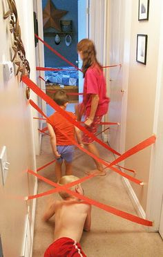 DIY Lazer Maze Kids Activity. You just need some a roll of crepe paper and some masking tape. Your kids will go crazy designing mazes and working their own way through them. Learn more here. <3