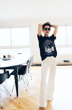 Flattering French-Girl Rule #4: Choose well-tailored flares. Relaxed different Indy style white pant band t-shirt graphic