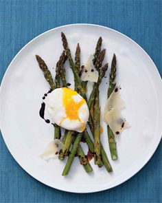 A poached egg on top of roasted asparagus makes for a creamy finish, while reduced balsamic vinegar mimics an aged vinegar and lends sweetness to this spring dish.