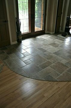 Slate entryway to protect hardwood floors at french door for when i i like the combination of stone near the entry where dirty shoes can be taken off to the wood flooring maybe we could round ours off like this if we solutioingenieria Gallery