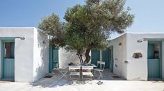 Lovely summer house in the Greek island of Antiparos Wish I was in this cute garden now, under the olive tree!