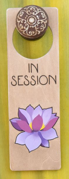 https://www.etsy.com/shop/DesignsByHeidiLynne Wood-burned door hanger sign with lotus flower, In Session door sign for therapy or spa.